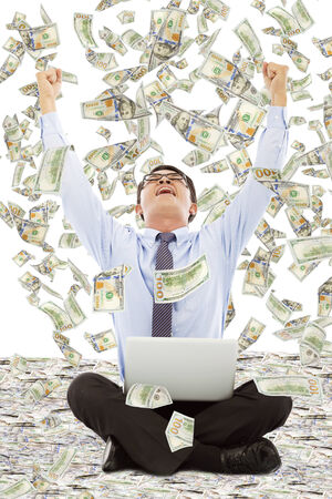 aisa: exciting young businessman raise hands with money Stock Photo