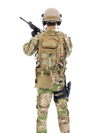 back view of soldier with rifle or sniper over white  photo