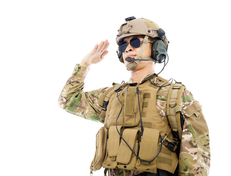 Soldier in military uniform  saluting over white  photo