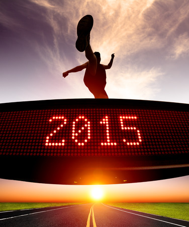 matrix: happy new year 2015.runner jumping and crossing over matrix display for celebrating 2015 Stock Photo