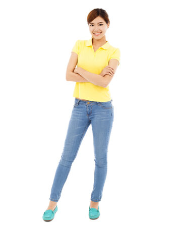 cross arms: young woman standing and cross her arms