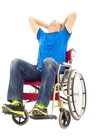 paralysis: depressed and handicapped man sitting on a wheelchair Stock Photo
