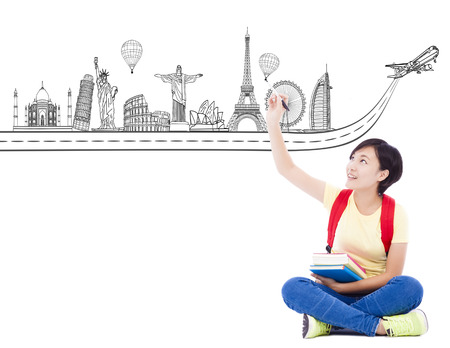 young student girl drawing a travel trip landmark