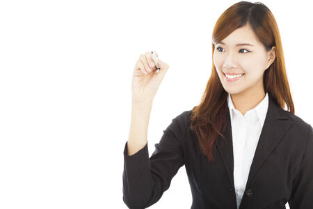 confident business woman standing and holding a pencil photo