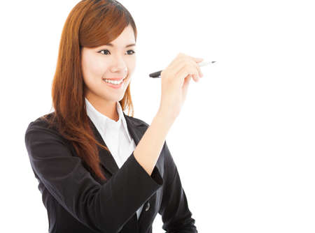 smiling business woman standing and holding a pencil photo