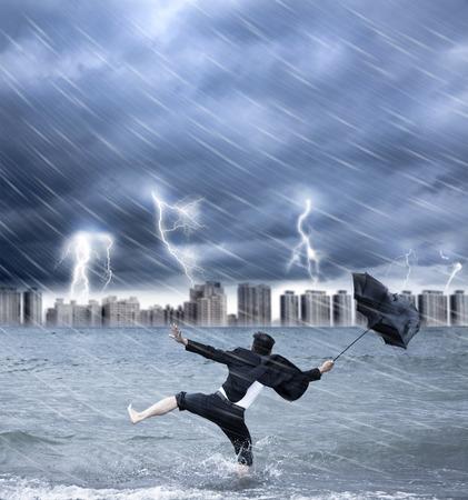 businessman holding an umbrella with thundershower photo