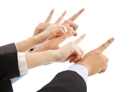 moving down: business people hands point tosame direction Stock Photo