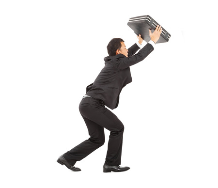 terrified businessman using briefcase to protect.  photo