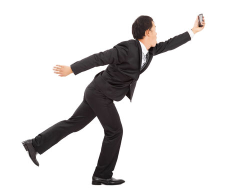 businessman  running busily and holding a smart phone photo