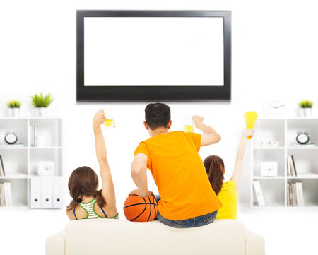 young people so excited to yelling and while watching tv Stok Fotoğraf