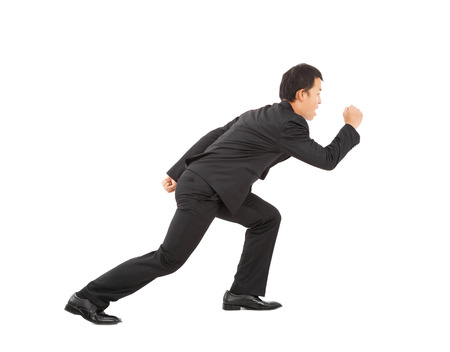 businessman jumping: asian young businessman sprinting isolated on white background