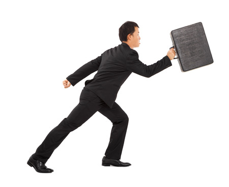positive businessman running and holding briefcase photo
