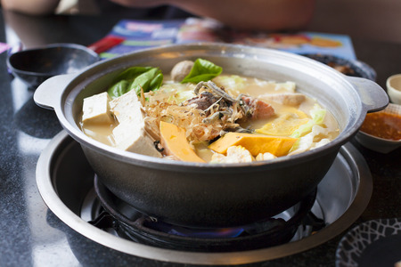 boiled: japanese and asian cuisine. hot pot on background