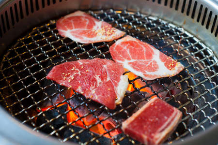 closeup of meat on a grill or barbecue. food background photo