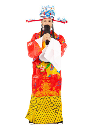 god of wealth chinese new year: Chinese New Year!  god of wealth make a greeting gesture Stock Photo