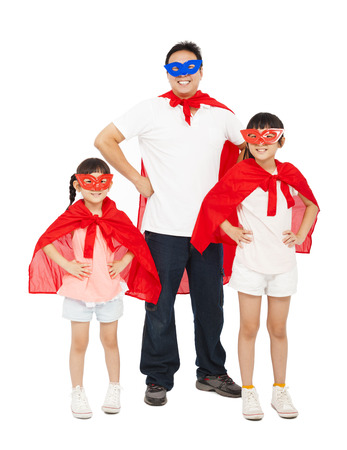 Father and daughters wearing superhero suit. isolated on white background