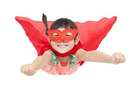volar: chica superhéroe volando aislado en fondo blanco Foto de archivo