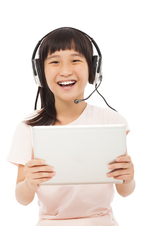 happy asian little girl holding a tablet with earphone