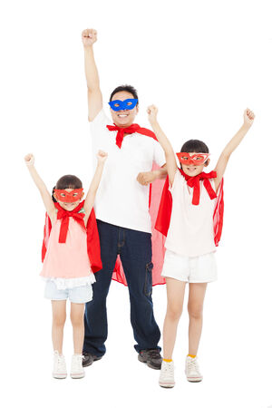 Father and daughters making a superhero pose with red cape . isolated on white background photo