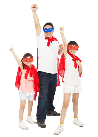 Father and daughters making a superhero pose with red cape photo