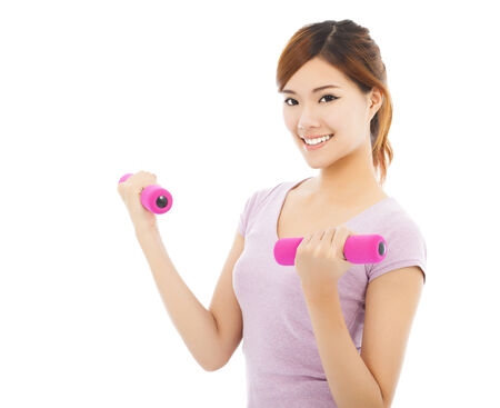 slender woman: Young woman working out with dumbbells isolated on white background