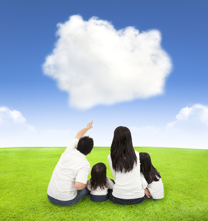 happy family on a meadow with cloud background photo