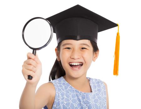 happy school little girl holding magnifier photo