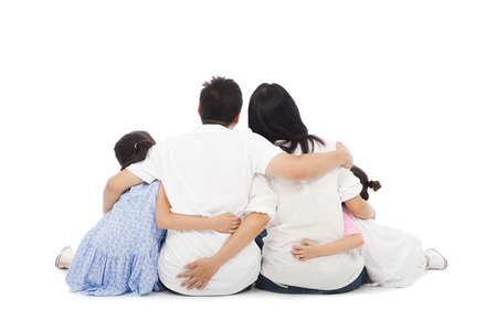 asian happy family sitting on floor isolated on white background Stock Photo