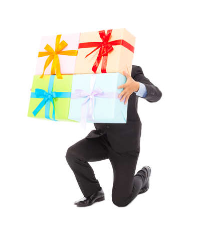 kneel down: Businessman holding gifts and kneel down . isolated on white background Stock Photo