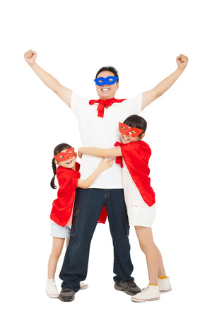superhero daughters hug father waist. isolated on white background