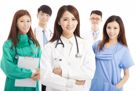 physicals: Professional medical doctor team standing over white background