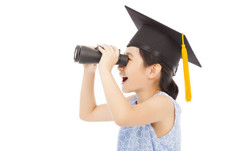 Little girl looking through binoculars. isolated on white photo