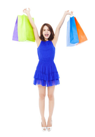 beautiful young woman with shopping bags. isolated on white background photo