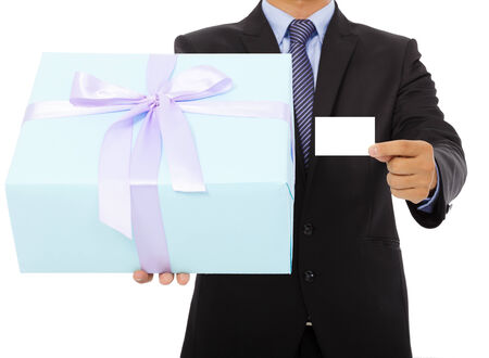 Businessman holding a gift box and a card. isolated on white background