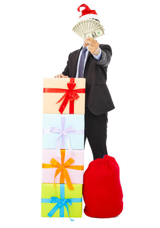 business man holding money with gift box and bag over white background photo