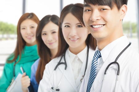 Professional medical doctor team standing in office Stock Photo