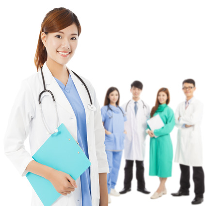 physicals: Professional medical doctor with her  team standing over white background