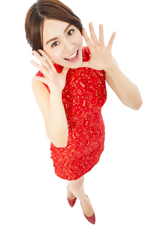 high angle shot of  young woman with cheongsam. isolated on white background