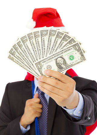 business man holding a christmas gift bag and money over white background