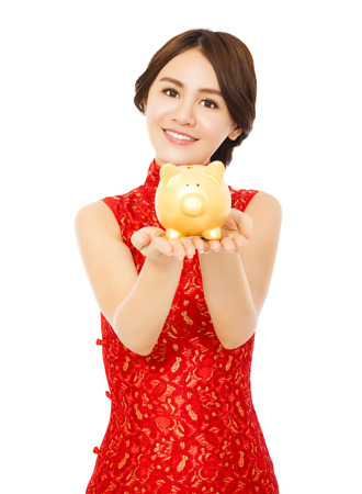 asian woman holding a golden piggy bank . happy chinese new year photo