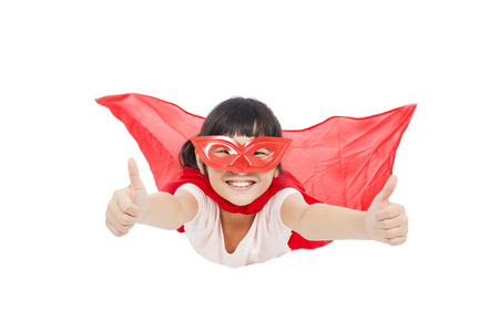 superhero kid flying and thumb up. isolated on white background