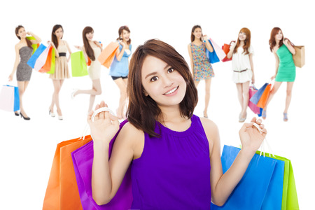 asian shopping women group holding color bags. isolated on white background photo