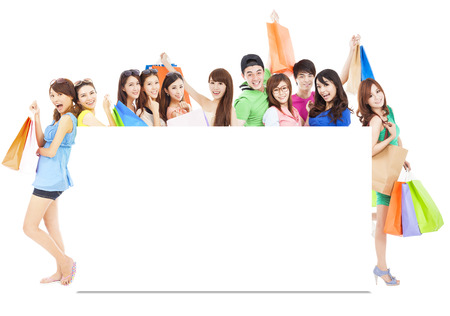 asian shopping women group holding color bags with a white board photo
