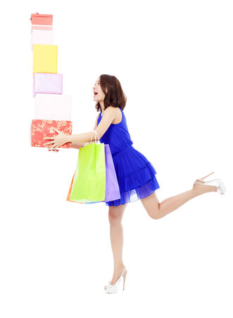 asian model: beautiful young woman holding shopping bag and gift boxes over white background Stock Photo