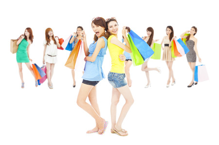 fashion bag: asian shopping women group holding color bags. isolated on white background