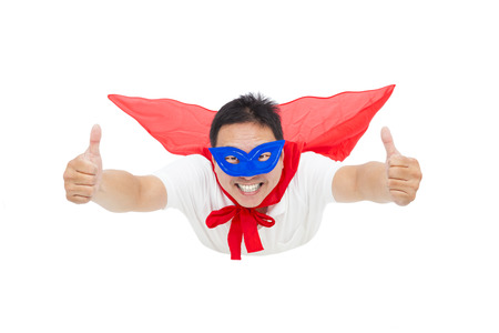 man flying and thumb up with red cape. isolated on white background photo