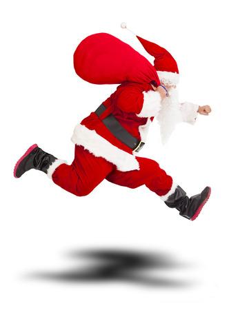 선물 가방을 들고 크리스마스 산타 클로스 메리와 흰색 배경에 running.isolated 스톡 콘텐츠
