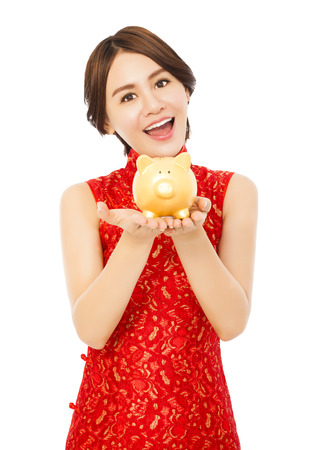 asian young woman holding a golden piggy bank . happy chinese new year photo