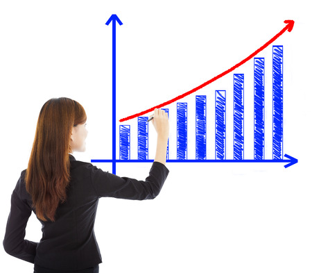 business woman draw a marketing growth chart over white background photo