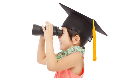 happy asian Little girl looking through binoculars. isolated on white background photo